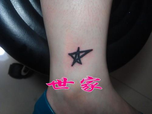 上海世家刺青纹身店作品:小腿五角星纹身