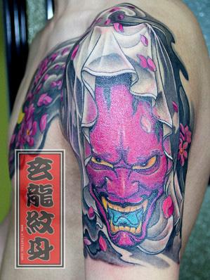 杭州纹身玄龙作品:男生手臂头像纹身图案