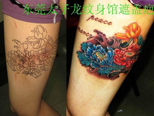 东莞纹身店太子龙纹身作品:大腿牡丹遮盖疤痕纹身