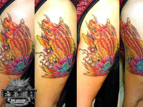 东莞纹身店太子龙纹身作品:手臂鲤鱼纹身