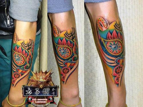 东莞纹身店太子龙纹身作品:小腿图腾纹身