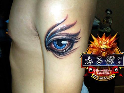 东莞纹身店太子龙纹身作品:手臂眼睛纹身