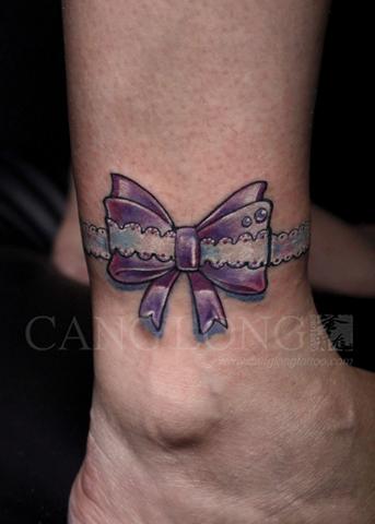 上海纹身店苍龙纹身作品:脚踝蝴蝶结纹身