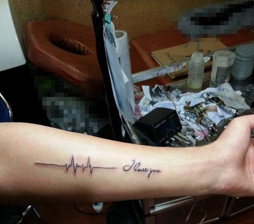 安庆凰颜艺术纹身店纹身作品:手臂心电图纹身图案